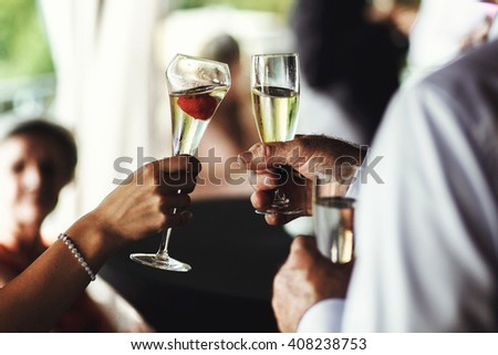 Happy wedding guests drinking champagne at reception closeup