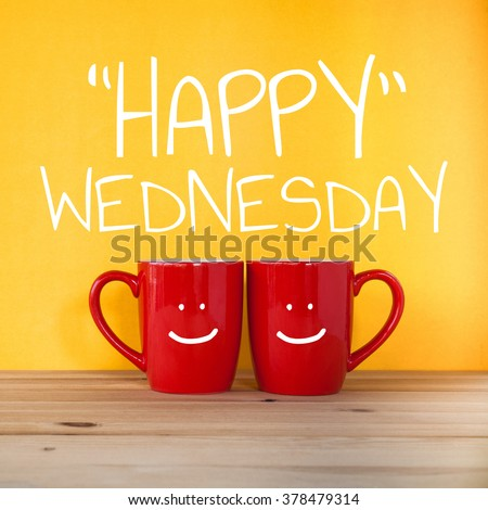 Happy wednesday word.Two cups of coffee and stand together to be heart shape on yellow background with smile face on cup. - stock photo
