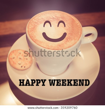Happy weekend with coffee cup on table  - stock photo