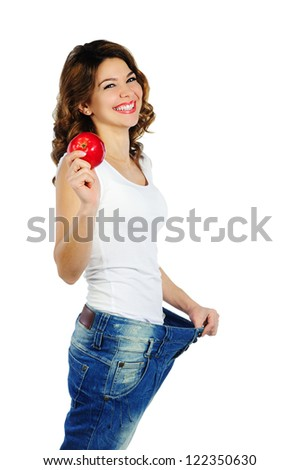 Happy weight loss woman with red apple isolated on white background - stock photo