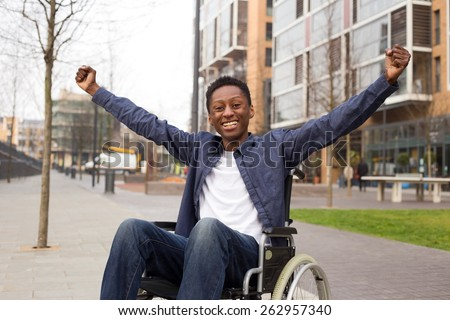 happy wheelchair user celebrating a success.  - stock photo