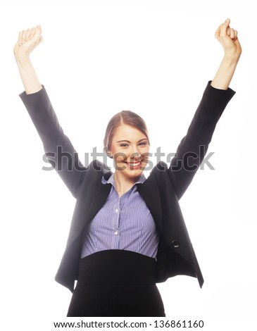 Happy winner. Successful business woman celebrating with arms up.