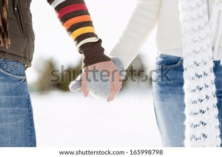 Happy winter couple walking outdoor - stock photo