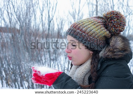 Happy winter time. Young girl  enjoying the winter - stock photo