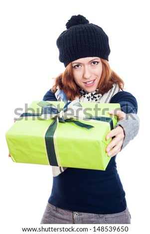 Happy winter woman giving present, isolated on white background. - stock photo