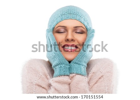 happy winter woman with a cap over his eyes
