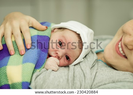 happy woman after birth with a newborn baby - stock photo