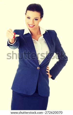Happy woman agent holding a key - stock photo