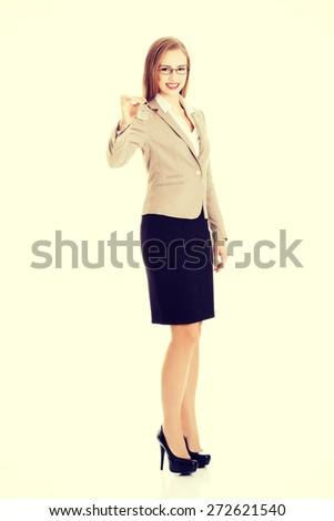 Happy woman agent holding the keys - stock photo