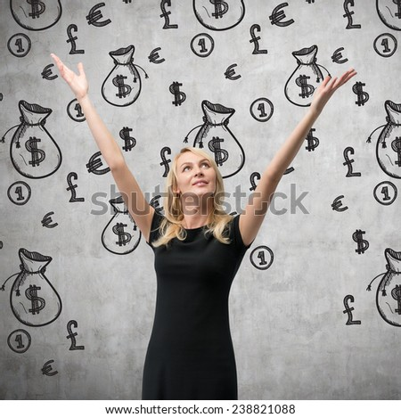 happy woman  and drawing money bags on wall - stock photo