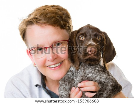 Happy woman and German wirehaired pointer puppy, 12 weeks old, white background, horizon format