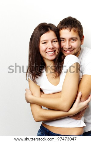 Happy woman and her husband looking at camera