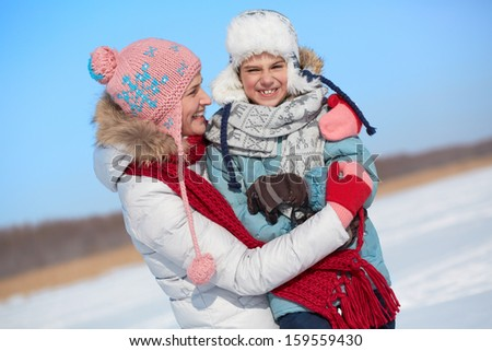 Happy woman and her son in winterwear - stock photo