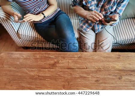 Happy woman and man hand point finger on phone and laptop on table,relationship ,the internet of things.Two business people touching on mobile phone while working and discussion, relaxing lifestyle