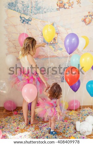 Happy woman and young girl celebrate birthday. Mother day concept - stock photo
