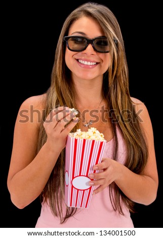 Happy woman at the movies wearing 3D glasses