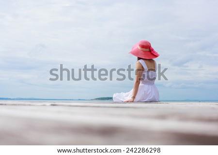 Happy woman beside the sea - stock photo