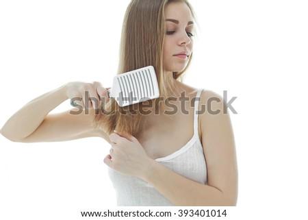 Happy woman brushing her beautiful healthy wavy hair - stock photo