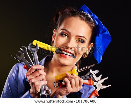 Happy woman builder with construction tools. - stock photo