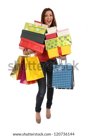 Happy woman carries shopping bags and birthday or christmas presents - stock photo