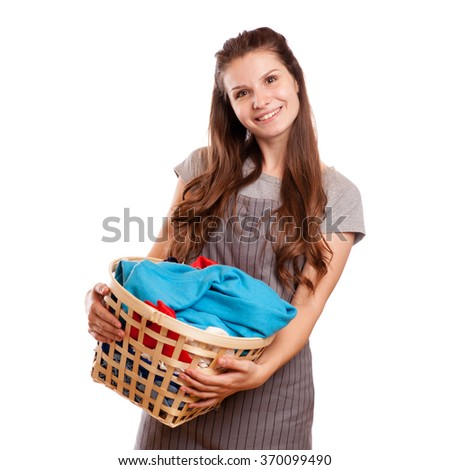 Happy Woman Carrying Laundry Basket Isolated on white - stock photo