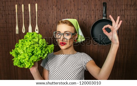 Happy woman cook with okay sign holding salad, close up - stock photo