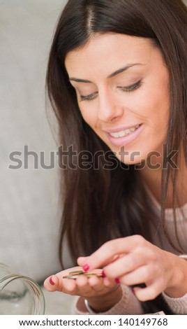 Happy Woman Counting Her Savings, Indoors - stock photo