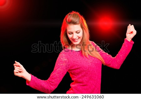 Happy woman dancing in a disco - stock photo