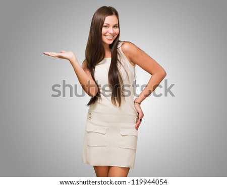 Happy Woman doing a gesture against a grey background - stock photo