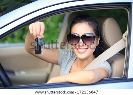 happy woman driver in her new car