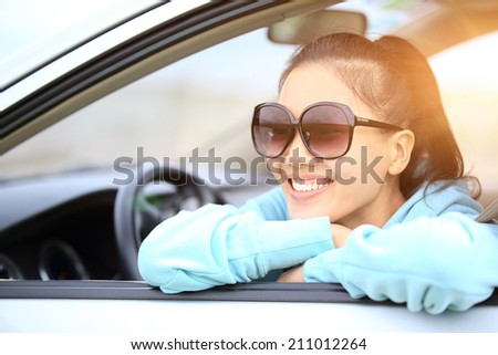 happy woman driver in her new car  - stock photo