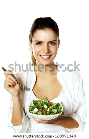 Happy woman eating healthy vegetable salad - stock photo