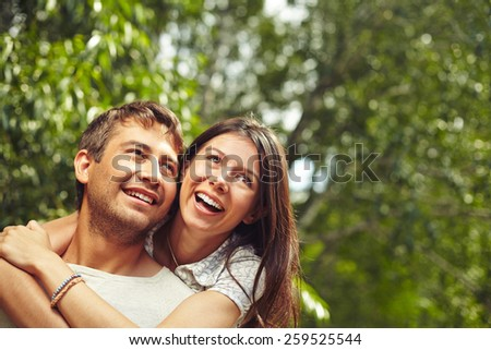 Happy woman embracing her husband - stock photo