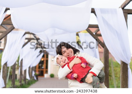 happy woman embracing her laughing girl - stock photo