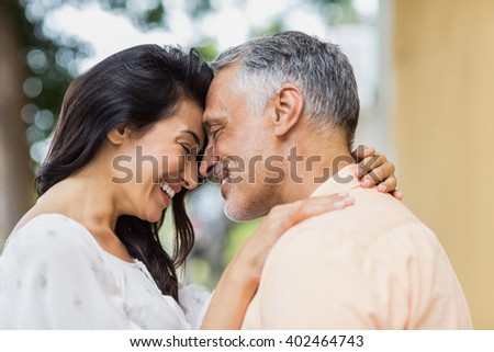 Happy woman embracing man with city