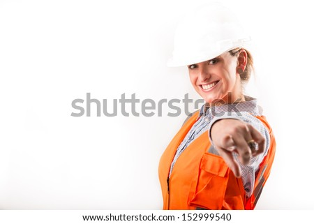 Happy woman engineer pointing with her hand - stock photo