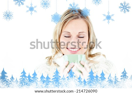 Happy woman enjoying a hot coffee against snowflakes and fir trees