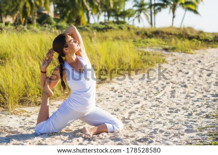 Happy woman enjoying in the countryside - stock photo