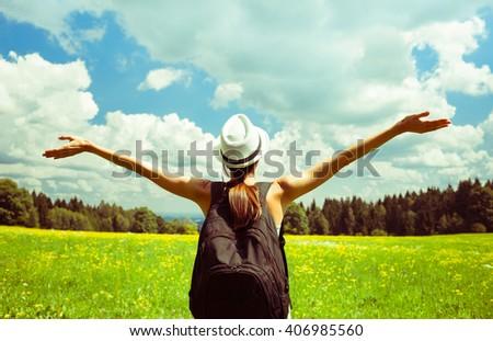 Happy woman enjoying the beautiful outdoors.  - stock photo