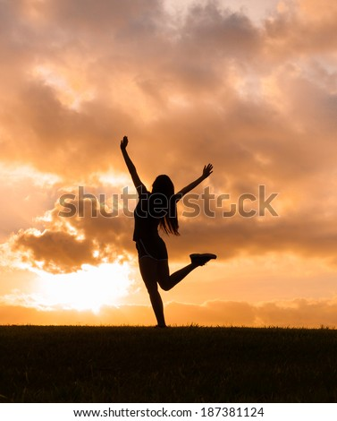 Happy woman enjoying the sunset/sunrise. Freedom concept. Enjoyment.