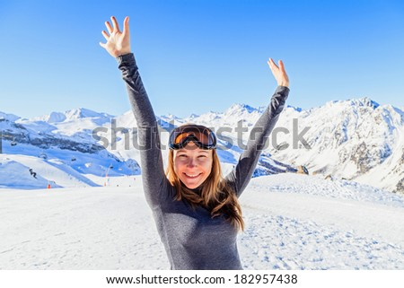 Happy woman enjoying the winter holiday in the Alps - stock photo