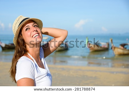 Happy woman enjoying travel vacation to Krabi, Thailand. Joyful brunette having fun and girl smiling on Railay Beach. - stock photo