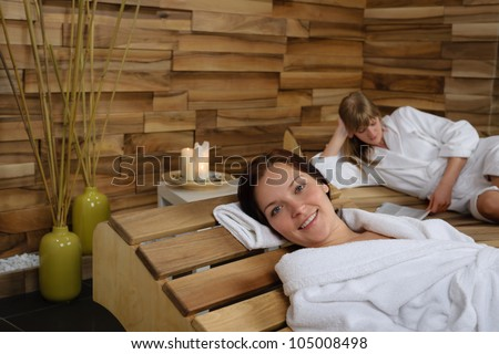 Happy woman enjoying wellness treatment at spa center