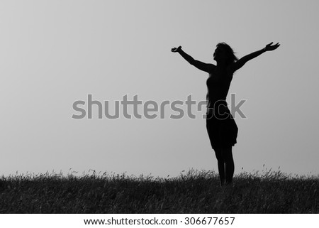 Happy woman enjoys outdoor.Happy woman Image is intentionally with grain and toned.