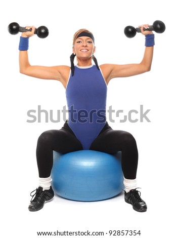 Happy woman exercising and working out with dumbells.