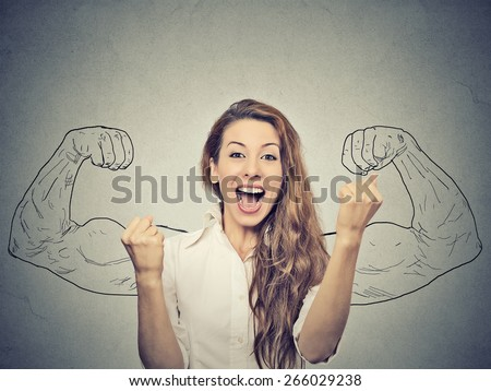 happy woman exults pumping fists ecstatic celebrates success on gray wall background   - stock photo