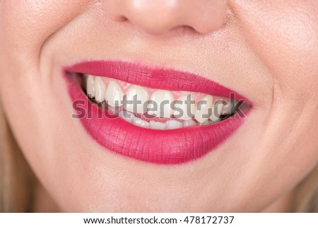 Happy Woman Face with Open Mouth. Bright Red Lipstick in Use. White Teeth. Studio Photo.