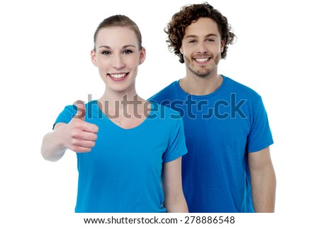 Happy woman gesturing thumbs up to camera - stock photo