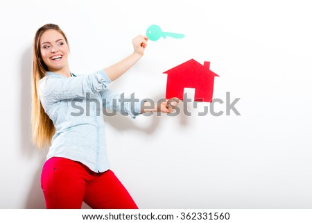 Happy woman girl holding paper house and key dreaming about new home house. Housing and real estate concept. - stock photo