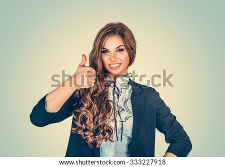 Happy woman giving thumbs up sign - isolated over green background wall. Happy beautiful girl. Positive human emotions, face expression life perception, feelings, body language, attitude perception  - stock photo